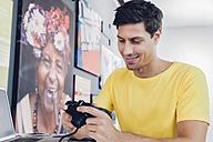 Smiling young man looking at camera - CHAF001042