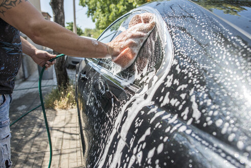 Man washing his car, close-up - DEGF000473