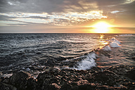 Indonesia, Bali, waves at beach in the evening - KRPF001563