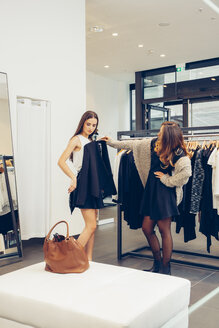Two young women shopping in a boutique - CHAF001360