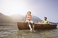 Austria, Tyrol, couple driving with boat on Walchsee - RBF002985