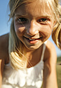 Portrait of smiling blond girl - MGOF000357