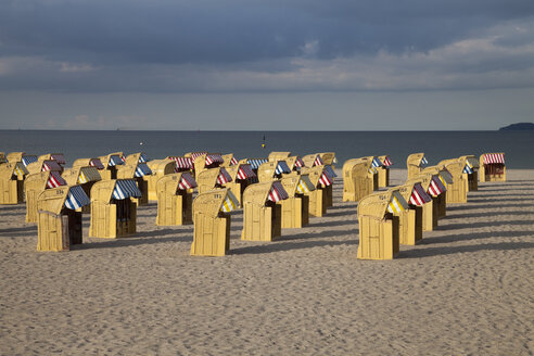 Germany, Luebeck Travemuende, view to beach with hooded beach chairs - WIF002250