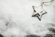 Christmas decoration on wood, wooden stars, artificial snow, copy space - SBDF002200