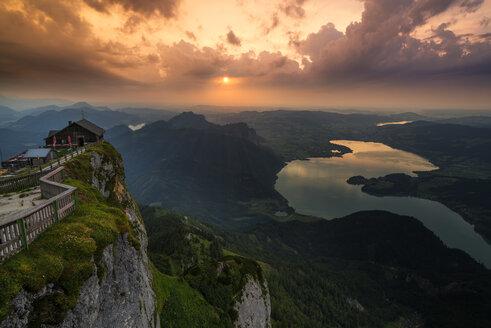 Austria, Salzkammergut, Mountain Schafberg and Lake Mondsee at sunset - MKFF000251
