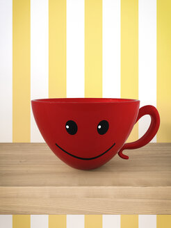 Smiling red cup on a shelf - AHUF000032