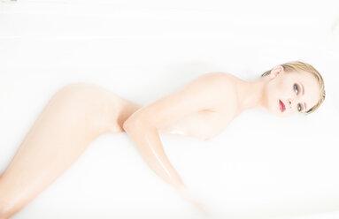 Young woman in milk bath - FC000720