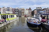 Netherlands, Amsterdam, Houses at town canal, tour boats in foreground - THA001422