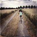 Germany, girl with bike on field path - LV003757