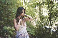 Young woman in the forest - RAEF000251
