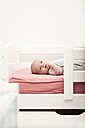 Portrait of baby lying on a cot - MFRF000333
