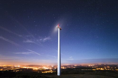 Spain, Galicia, Ferrol, Wind turbine under starry sky - RAEF000237