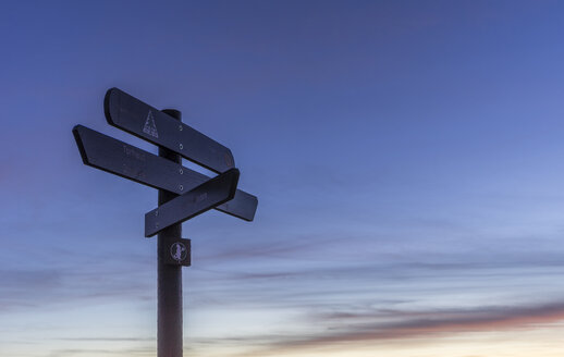 Germany, Saxony-Anhalt, Harz National Park, sign posts at Brocken in the evening - PVCF000522