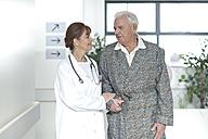 Doctor with elderly patient on hospital floor - ZEF007362