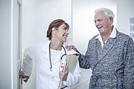 Doctor with elderly patient in hospital - ZEF007259