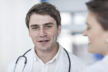 Smiling doctor talking to woman in hospital - ZEF007268