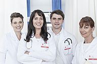 Portrait of smiling doctors and nurses in hospital - ZEF007269