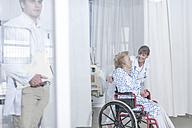 Doctor and elderly patient in wheelchair - ZEF007273