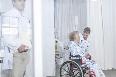 Doctor and elderly patient in wheelchair - ZEF007273