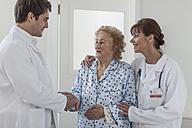 Two doctors with elderly patient - ZEF007281