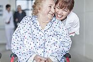 Doctor caring for elderly patient in wheelchair - ZEF007292