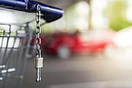 Shopping cart and car park, red car in the background - FRF000295
