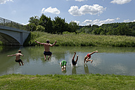 Germany, Bavaria, kids and man jumping into River Loisach - LBF001168