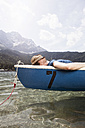Germany, Bavaria, Eibsee, man in rowing boat on the lake - RBF003039