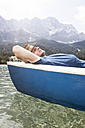 Germany, Bavaria, Eibsee, man in rowing boat on the lake - RBF003041