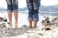 Close-up of two children standing at lakeshore - MFRF000268