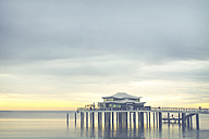 Germany, Niendorf, view to sea bridge with tea house at sunrise - PUF000403