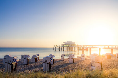 Germany, Niendorf, view to Timmendorfer Strand with hooded beach chairs and sea bridge - PUF000412