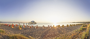 Germany, Niendorf, view to Timmendorfer Strand with hooded beach chairs and sea bridge - PUF000399