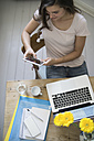 Young woman at home office using digital tablet - RIBF000142