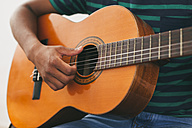 Hand of man playing guitar - EBSF000852