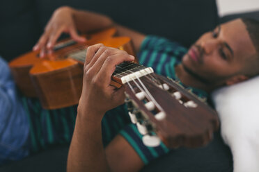 Man playing guitar, close-up - EBSF000832