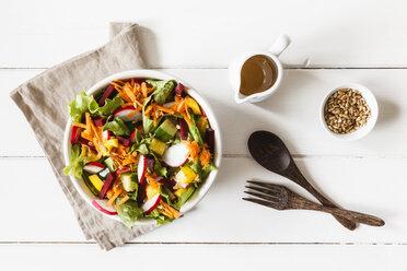 Mixed salad in bowl on wood - EVGF002016