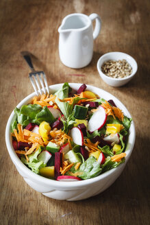 Mixed salad in bowl on wood - EVGF002032