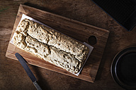 Home-baked wholemeal bread, gluten-free, bread knife on chopping board - EVGF002000