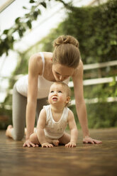 Woman kissing her little daughter - ABF000635