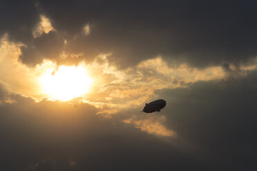 Germany, Oberschleissheim, Silhouette of Zeppelin NT, mid-air - PEDF000061