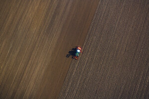 Tractor on field, aerial view - PEDF000132