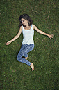 Woman lying on a meadow with closed eyes - MW000096