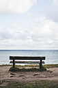 Germany, Nienhagen, wooden bench with view to the sea - ASC000278