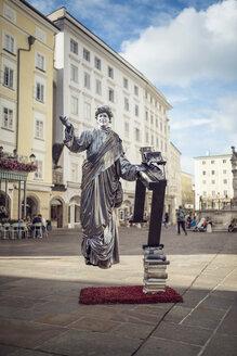 Austria, Salzburg, Street artist dressed as Mozart in city center - OP000059
