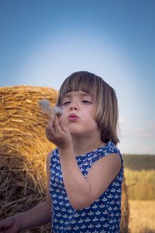 Portrait of little girl in front of a straw bale - LVF003761