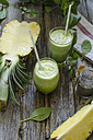 Two glasses of spinach pineapple smoothie with chia and mint - ODF001200