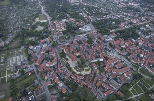 Germany, aerial view of Quedlinburg with collegiate church in the evening - PVCF000534