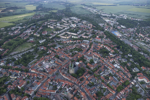 Germany, aerial view of Quedlinburg with St. Nicolas' Church in the evening - PVCF000537