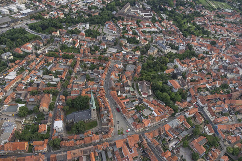 Germany, aerial view of Quedlinburg with St. Nicholas' Church in the evening - PVCF000551